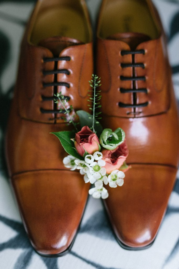 groom's shoes with boutonniere